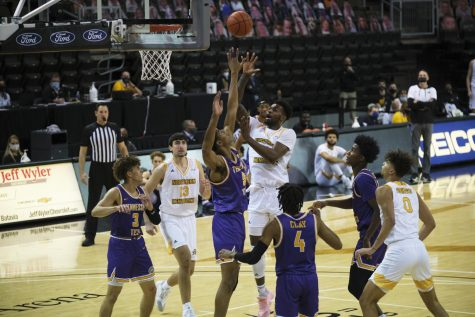 Adrian Nelson (4) shoots over a Tennessee Tech defender. Nelson finished with 10 points and 14 rebounds.