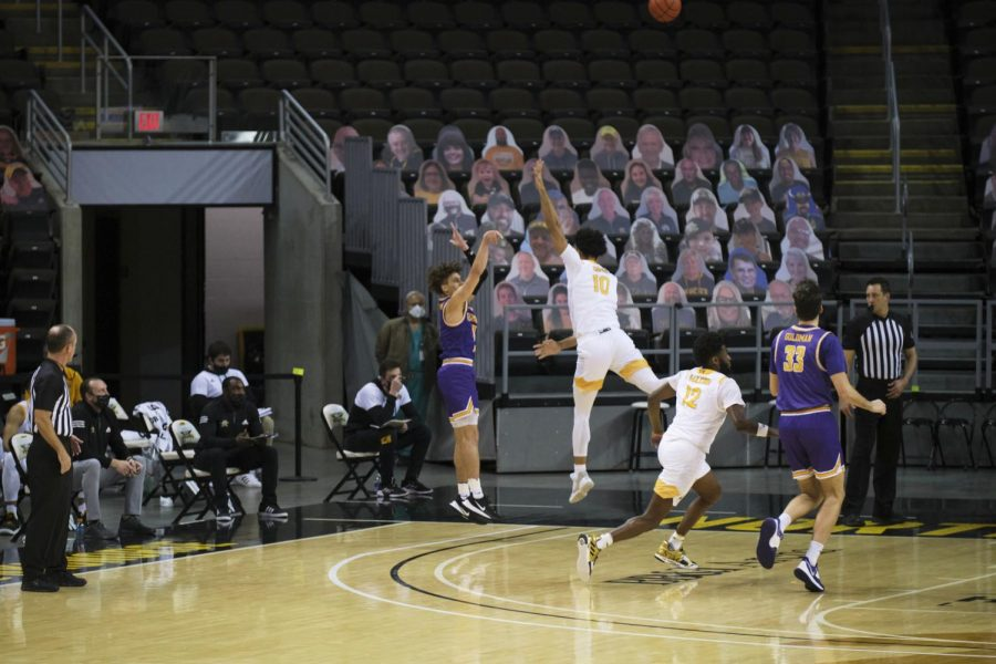 John Harge (10) defends a Tennessee Tech three-point attempt.