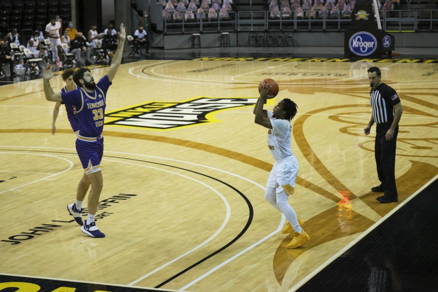 Guard Bryson Langdon draws a Tennessee Tech defender in the air with a pump-fake.