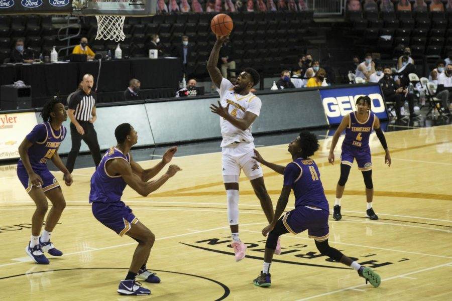 Adrian Nelson (4) shoots a jumper in the lane against Tennessee Tech.