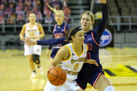 Guard Lindsey Duvall (5) drives to the hoop against a Robert Morris defender. Duvall finished the game with 21 points and 13 rebounds.