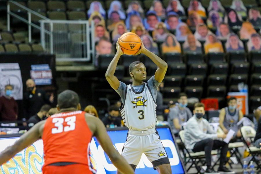 Marques Warrick (3) looks for an open teammate in NKU's game against Youngstown State. Warrick finished with 18 points in the victory.