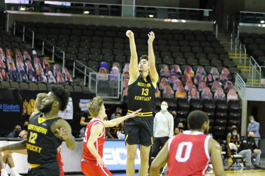 David Böhm (13) attempts a jumper against IUPUI.
