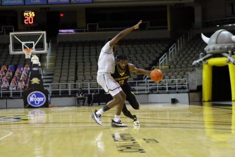 Trevon Faulkner (12) drives past a Purdue Fort Wayne defender. The Norse would defeat the Mastodons 70-68.