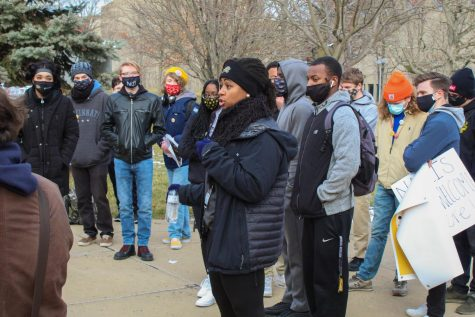 Amira Bryant speaks to the crowd during the protest.