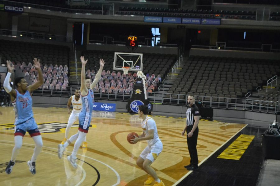 NKU guard Jake Evans draws multiple UIC defenders into the air during Saturday's game.