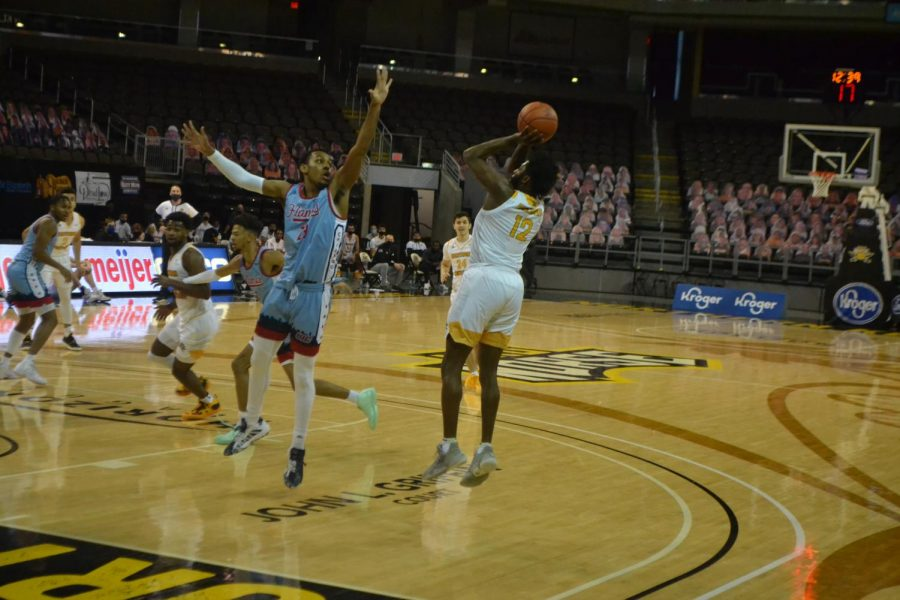 NKU guard Trevon Faulkner shoots a jump shot from the corner against UIC. Faulkner led the Norse with 15 points on Saturday.