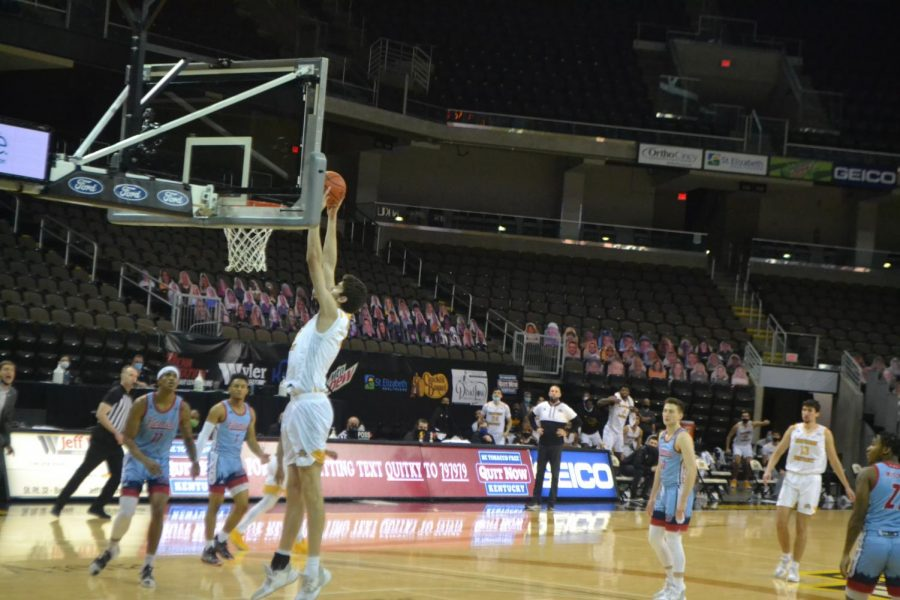NKU center Noah Hupmann throws down a two-handed slam dunk against UIC. Hupmann finished with 4 points.