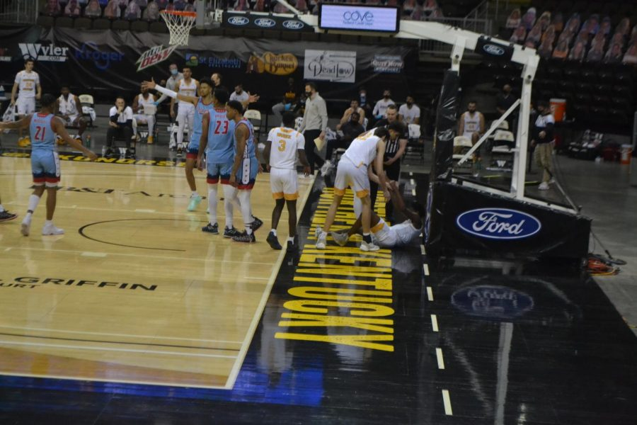 A group of NKU players help their teammate Trevon Faulkner back to his feet.