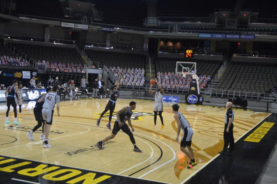 Adham Eleeda (1) shoots a three against UIC. Eleeda had two made threes in the game.