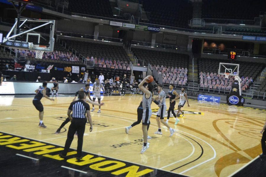 NKU forward David Böhm shoots a jump shot against UIC. Böhm finished the night with four points.