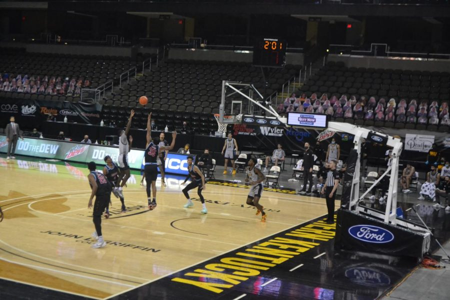 NKU guard Marques Warrick shoots a jump shot over a UIC defender on Friday night.