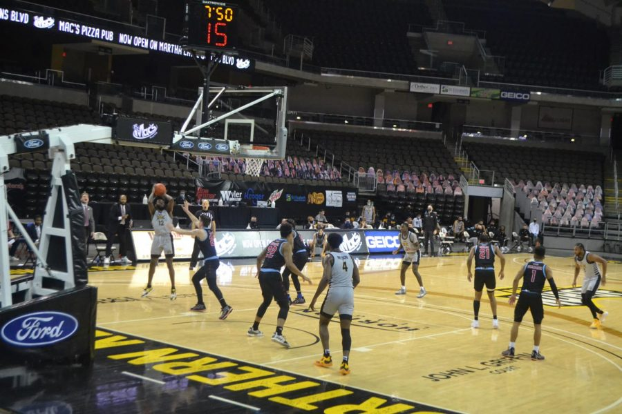 NKU guard Trevon Faulkner attempts a shot against UIC. Faulkner finished the night with 25 points.