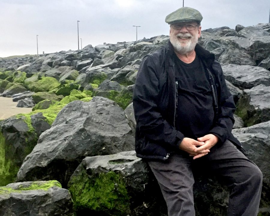 Stephen Leigh sitting on rocks in Ireland.