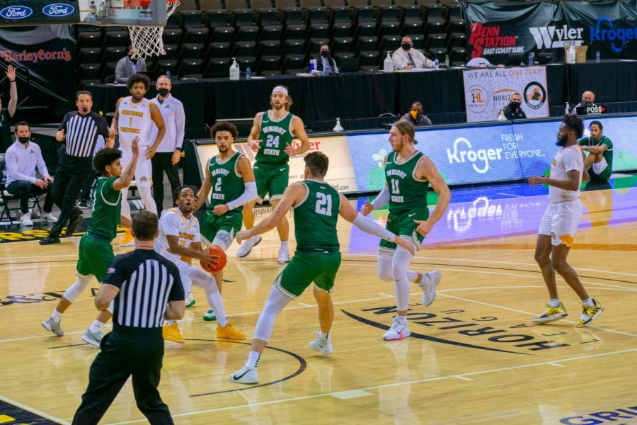 Bryson Langdon (11) gets to the basket with a group of Wright State defenders around him on Friday night.