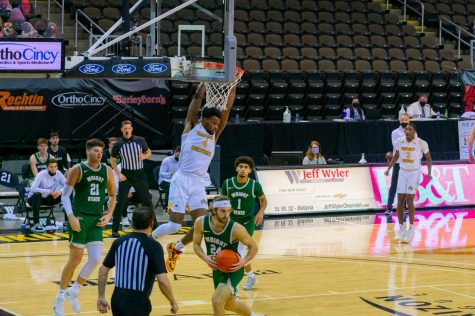 Adrian Nelson (4) finishes off a slam dunk against Wright State on Friday night.