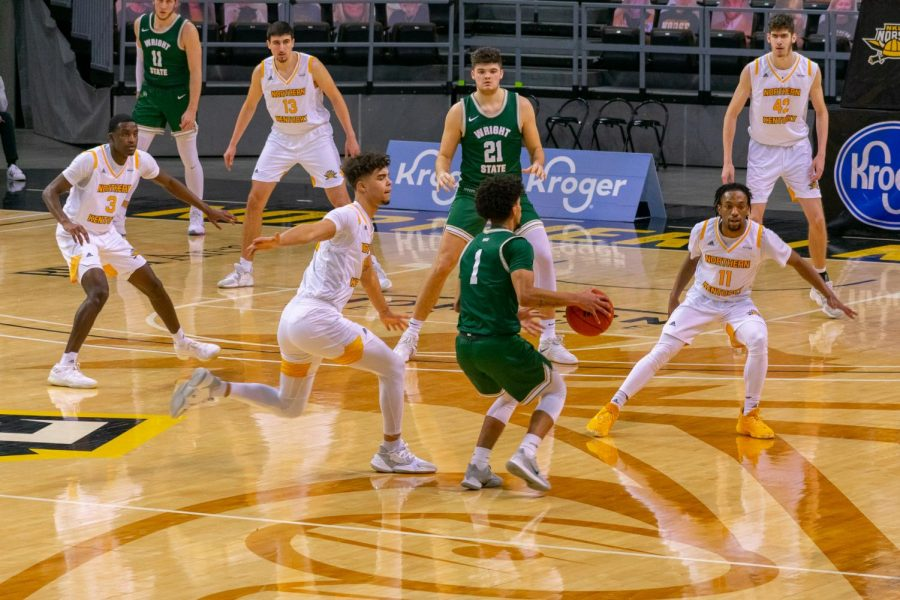 Trey Robinson and Bryson Langdon guard Wright State's Trey Calvin on the perimeter.