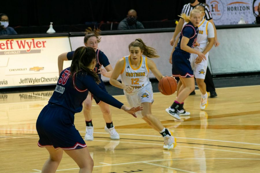 Carissa Garcia (12) drives into the lane against Robert Morris on Thursday night.