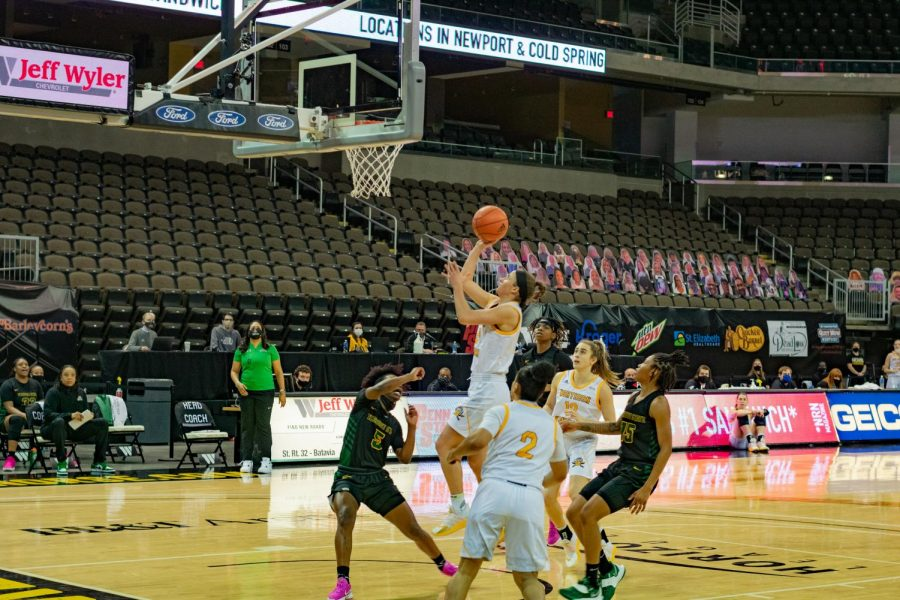 Guard Lindsey Duvall finishes at the hoop for the layup against Wright State.