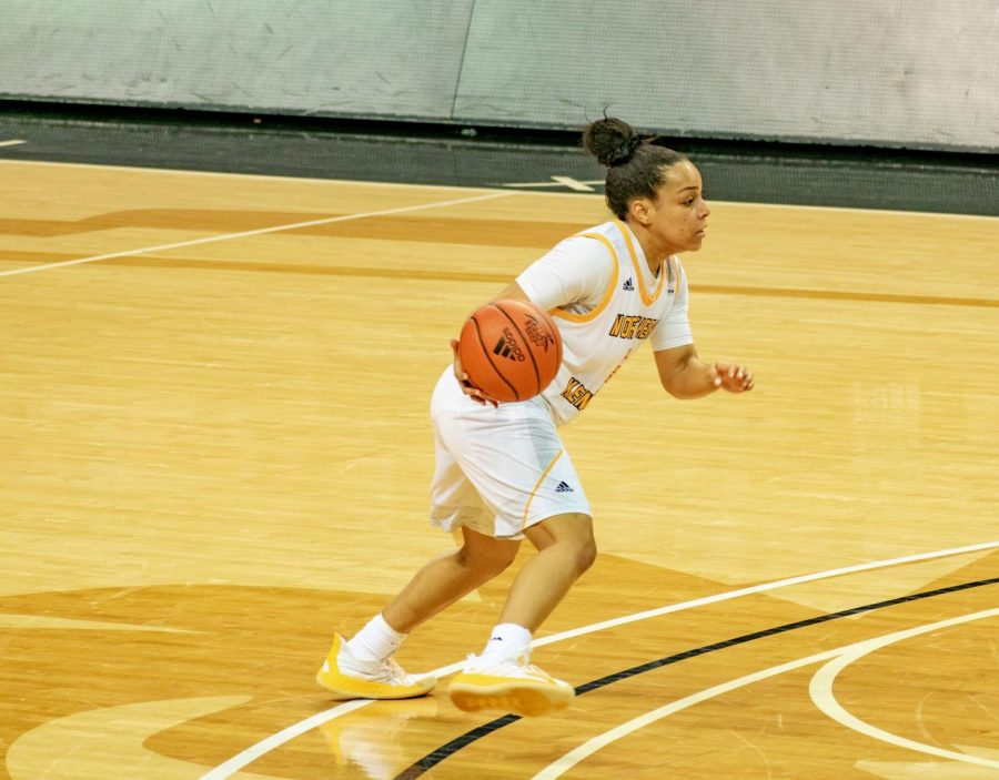 Guard Ivy Turner dribbles the ball at the top of the key.