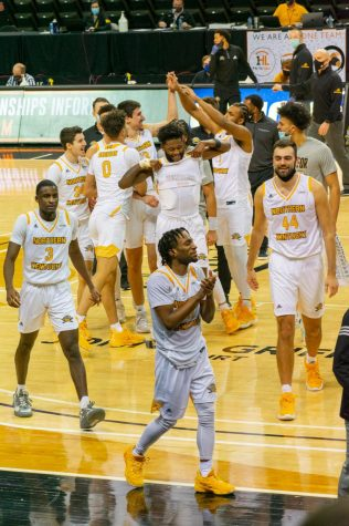 NKU players celebrate the dramatic win over Detroit Mercy in the Horizon League quarterfinals.