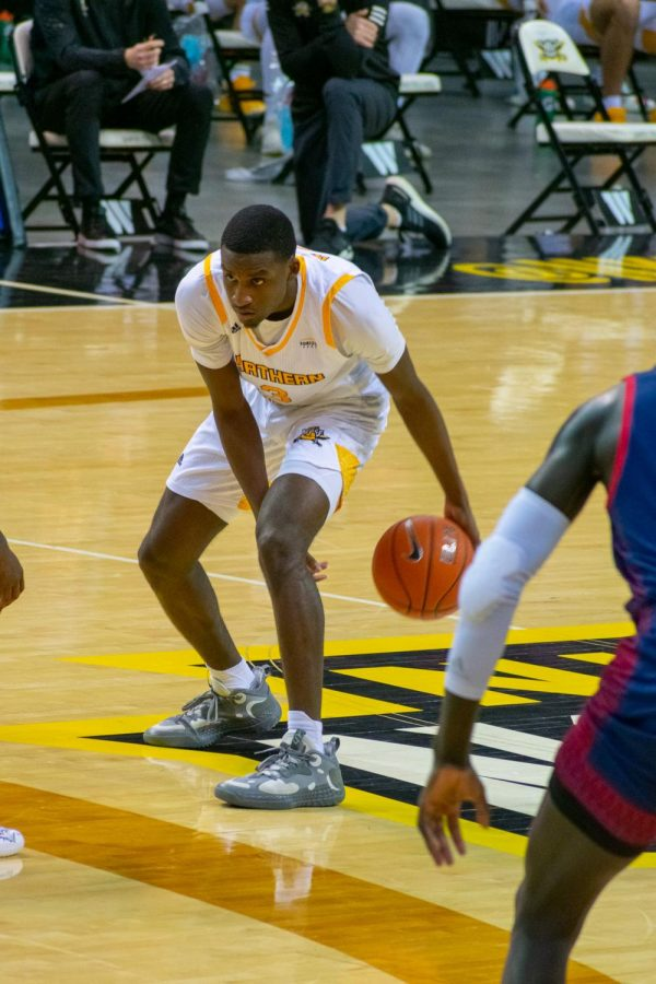 Marques Warrick dribbles the ball through his legs against Detroit Mercy. Warrick finished with 20 points.