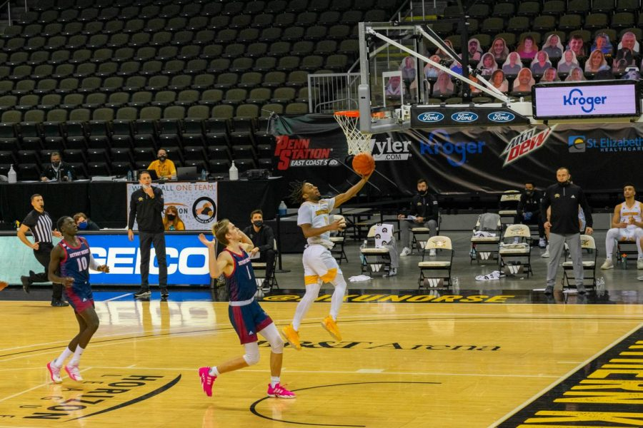 NKU guard Bryson Langdon scores a layup in the fast break for the Norse against Detroit Mercy.