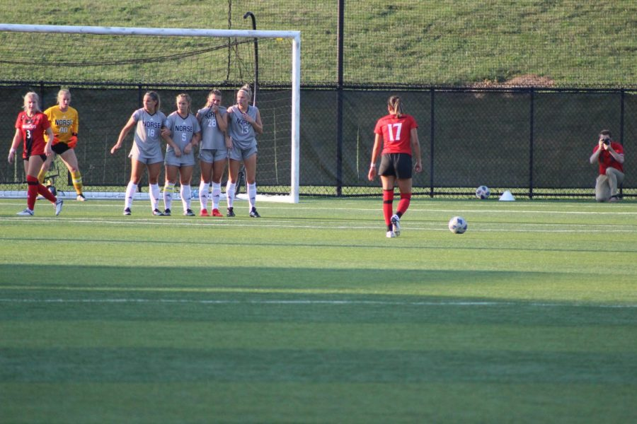 NKU players prepare to defend a shot during Thursdays match against Cincinnati.