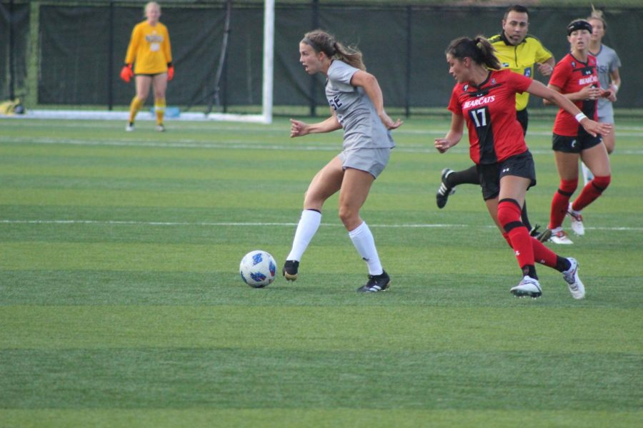 NKU forward Annie Greene dribbles the ball during NKUs 2-1 loss to Cincinnati on Thursday. Greene scored the lone goal for the Norse on a penalty kick.