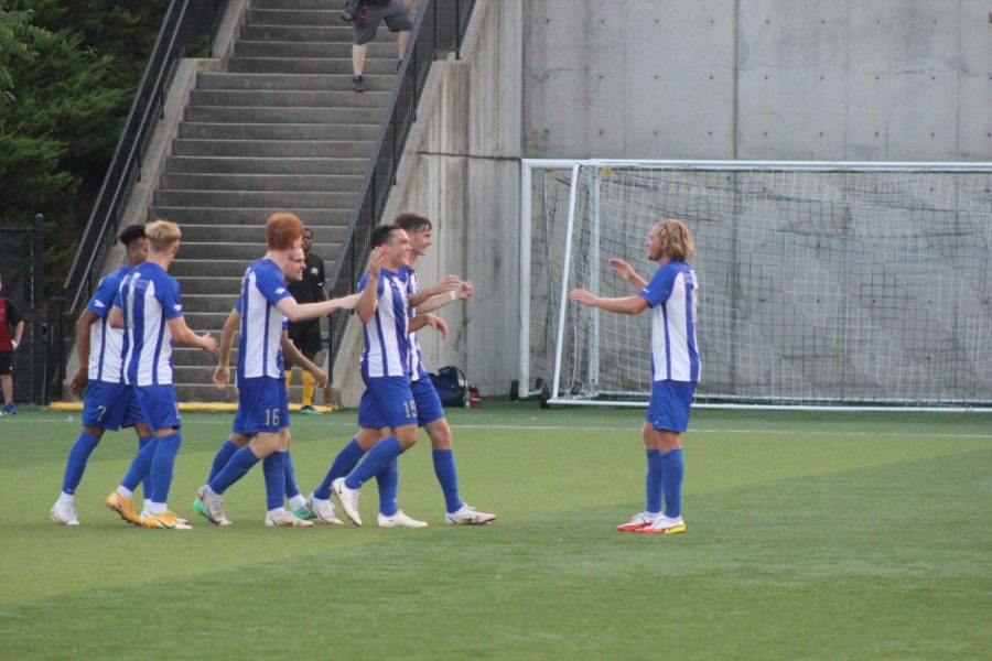 Kentucky players celebrate their first goal of the match against NKU on Friday night.