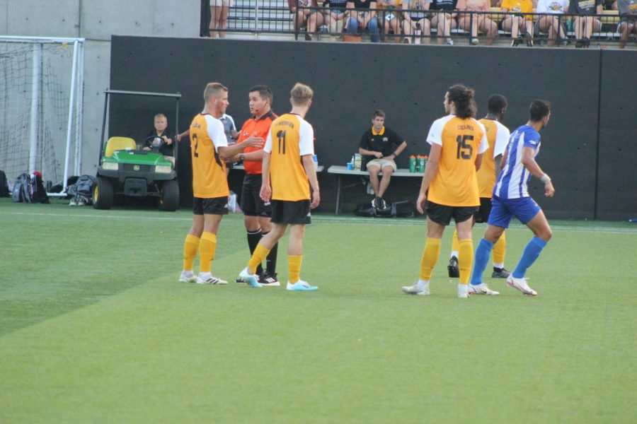 Several NKU players plead their cases to the referee to no avail after a Kentucky goal in the first half.