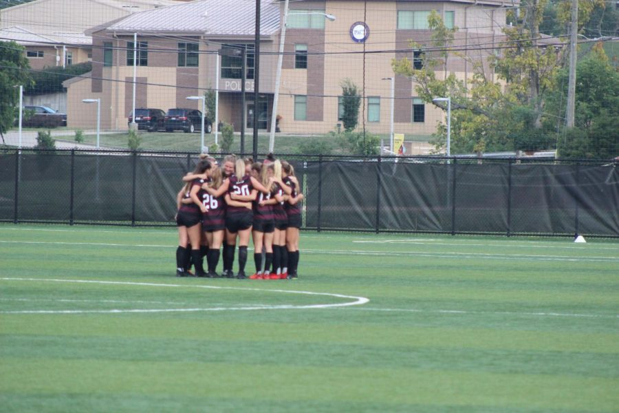 Eastern Kentucky players huddle before their match against Northern Kentucky on Sunday.