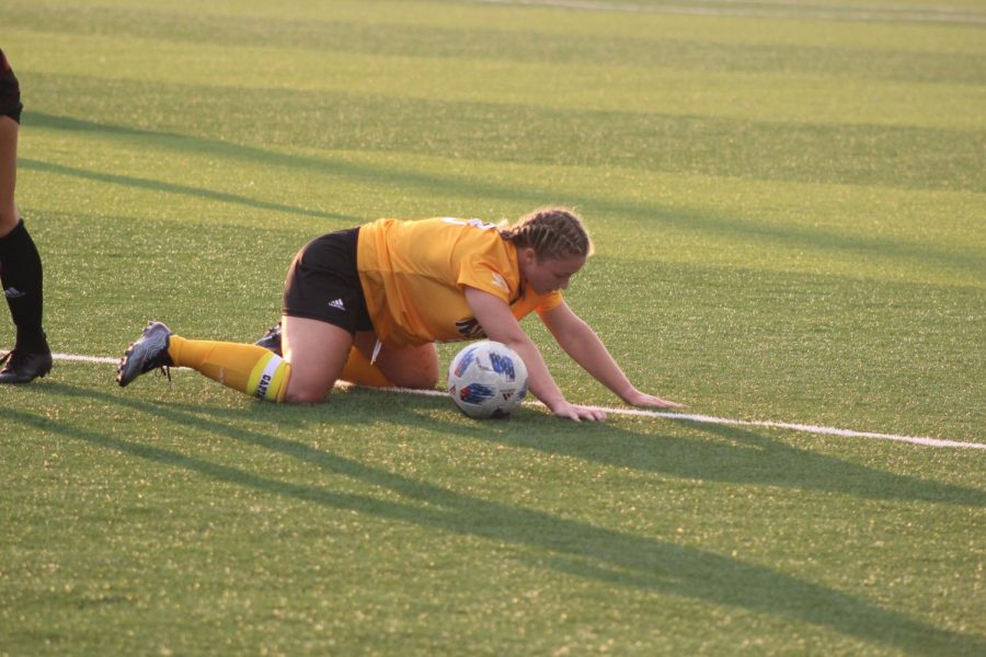 NKUs Ashleigh Cronin falls to the ground during the match against Eastern Kentucky on Sunday.