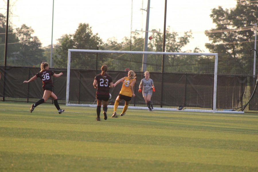 Mimi Stines rushes up to receive the ball from teammate Shelby Wall (13) during NKUs 2-1 win over Eastern Kentucky on Sunday.
