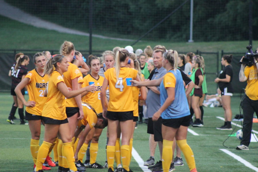 The NKU womens soccer huddles on the sideline for a water break during a match against Eastern Kentucky.