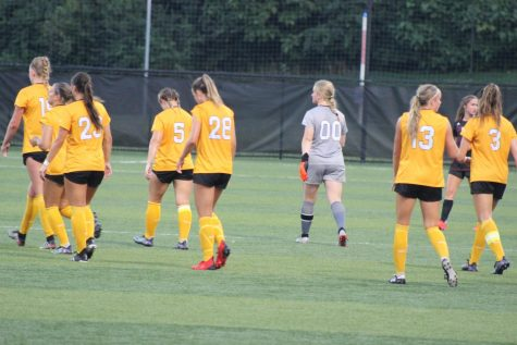 Members of the NKU womens soccer team walk back on to the field following a break in the action against Eastern Kentucky.