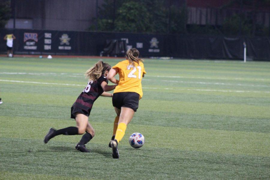 NKU forward Annie Greene jostles for the ball during NKUs 2-1 win over Eastern Kentucky on Sunday.