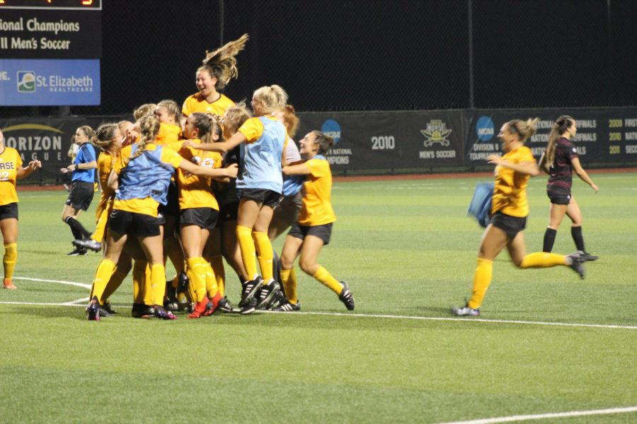 NKU players celebrate the golden goal by Chloe Mills during the Norse 2-1 win over Eastern Kentucky at NKU Soccer Stadium on Sunday.