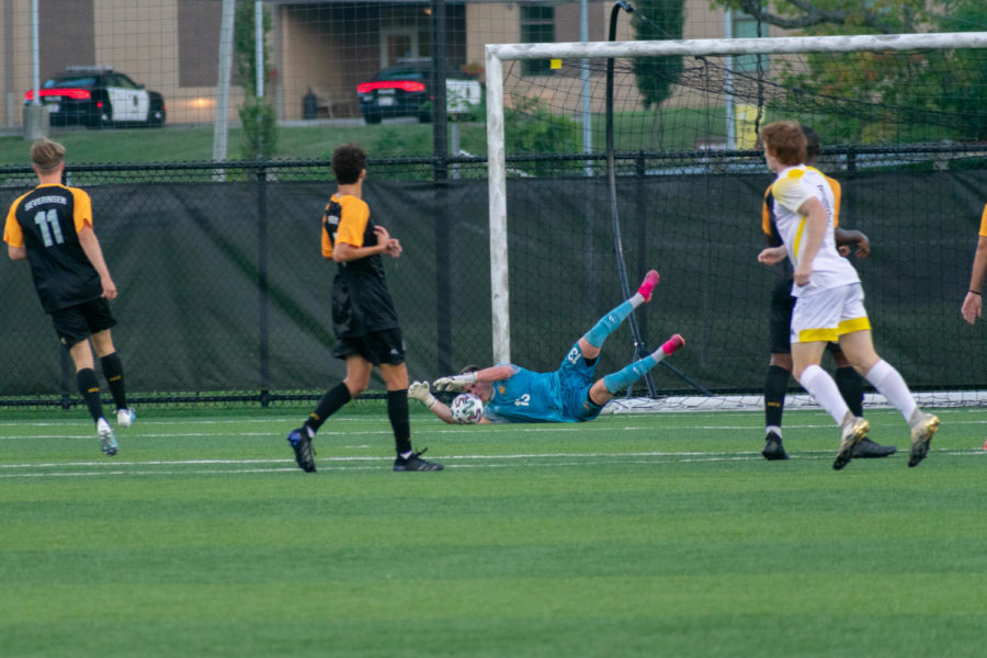 NKU goalkeeper Daniel Bermingham (13) makes a diving save during the Norse 3-0 win over Centre on Saturday.