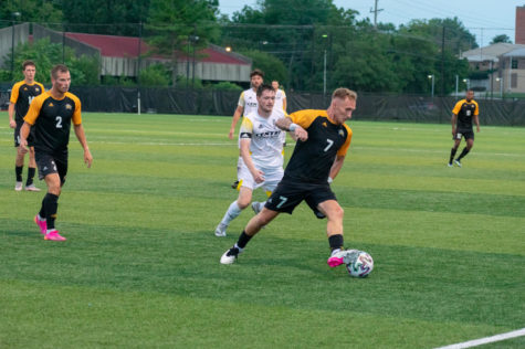 NKU forward Dylan Bufton (7) dribbles the ball through the defense during NKUs win against Centre on Saturday.