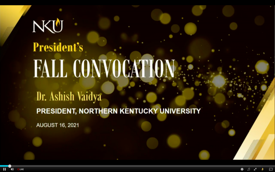 NKU Fall Convocation screen, black and gold with spots all around