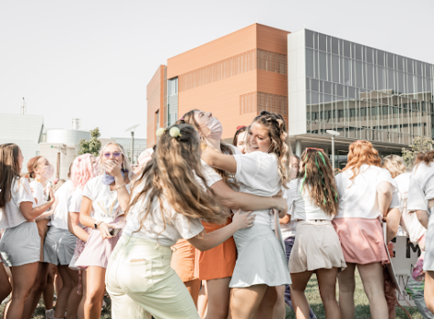A group of girls in one of NKUs sororities embrace one another on Sunday during Bid Day festivities.