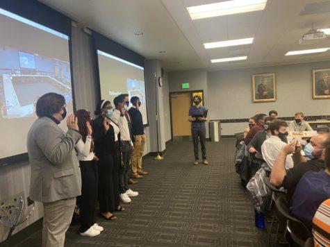 The induction of six new SGA senators in the Student Governance room