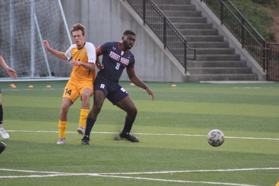 NKU midfielder Ryan Godding fights through contact during Saturdays loss to Robert Morris.