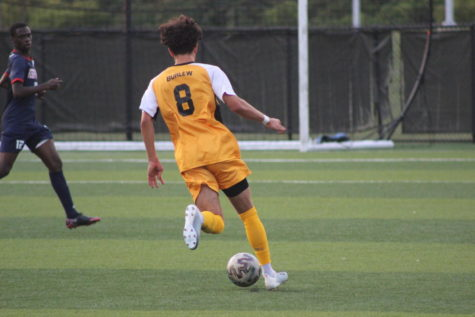 NKU sophomore Roberto Burlew (8) dribbles in the open field against Robert Morris on Saturday.
