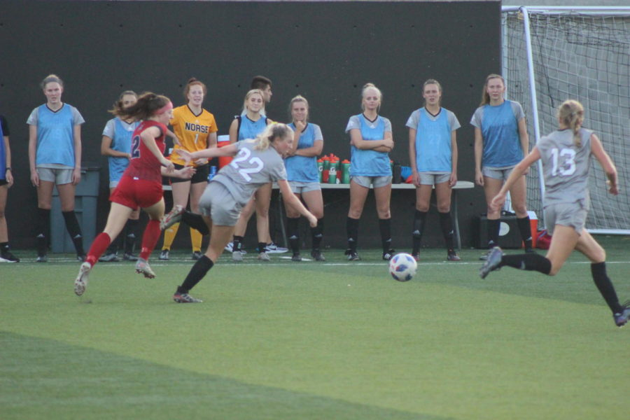 NKU defender Taylor Abbott (22) chases down the ball near the sideline during Thursdays victory.