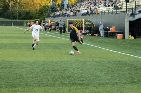 NKU forward Sam Robinson (17) dribbles the ball during NKUs loss to Wright State on Saturday.