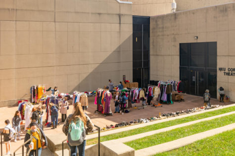 Students shopping around the many racks of costumes outside Corbett Theatre at SOTA.