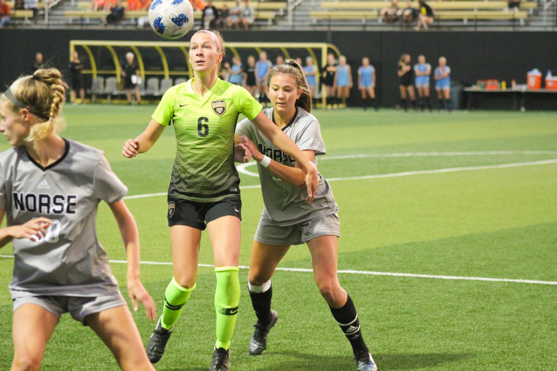 NKU senior Lily Menssen (3) defends Oaklands Jayna Fraser during the Norse 3-0 loss on Thursday.