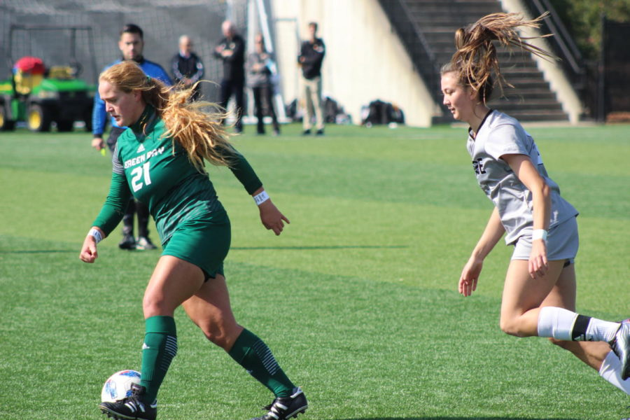 NKU defender Lily Menssen defends Green Bays Sarah Teubner during the match on Saturday. Menssen was one of seven NKU seniors honored for Senior day.